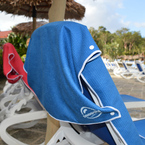 Snappy Towels microfiber beach towels attach over the back of your chair so that they won't blow away or fall down.