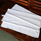 Kids beach towel, wearable microfiber towel for kids in White. Packs to 1/4 the size of cotton, great for travel, swimming lessons, vacations and more!