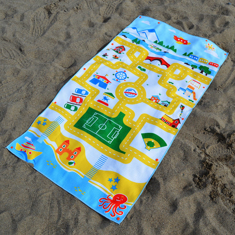 Play mat travel beach towel for kids. Kids swim towel with a play mat design on it. Beach town picture with roads for toy cars. It's a beach toy and a towel!