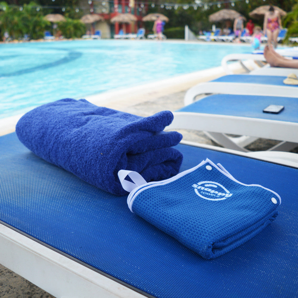 Compact yet comfortable microfiber beach towel. Snappy Towels pack up to 1/4 the size of a cotton beach towel. Stop carrying heavy cotton towels and start wearing a Snappy Towel.
