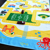 Play mat travel towels are designed with a play surface on one side for kids aged 1,2,3,4,5,6. Beach town design for action figures and toy cars.