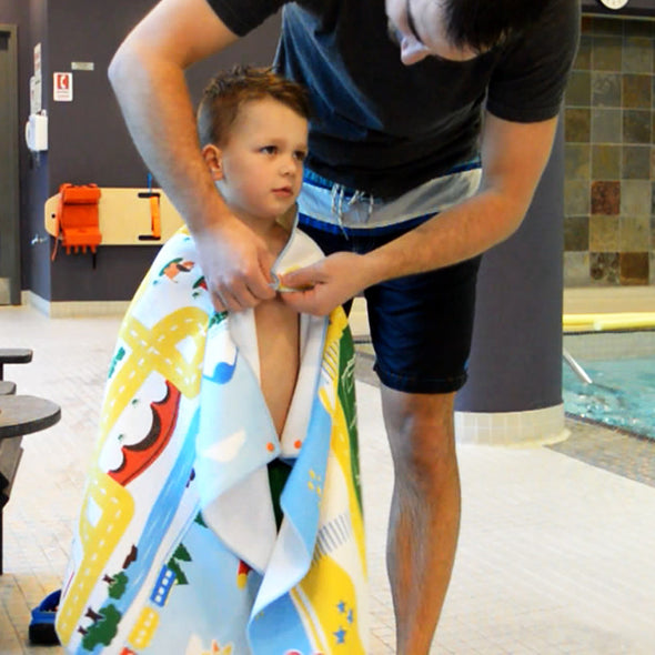 Play mat travel towel for kids, snaps on after a swim or bath to keep warm and dry off, hands-free!