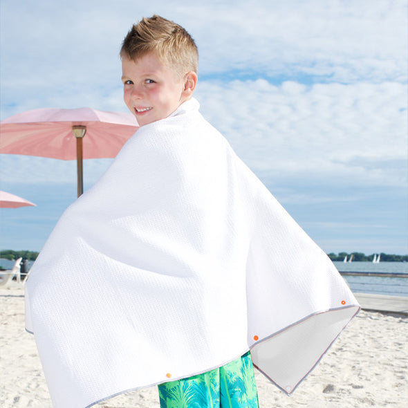 Play mat towels are wearable: they snap on with safe plastic snaps to be worn over the shoulders as a cape and other ways. Perfect after a swim or bath!
