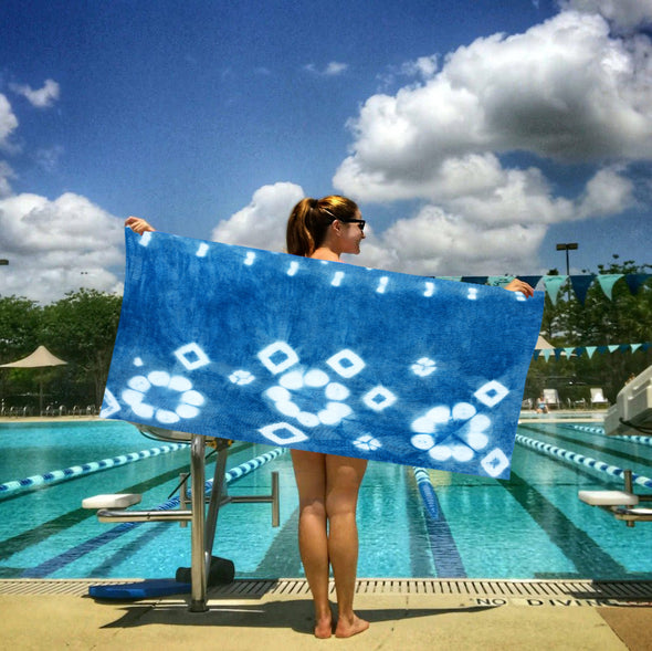 snappy eco collection sport towel indigo blue woman at pool