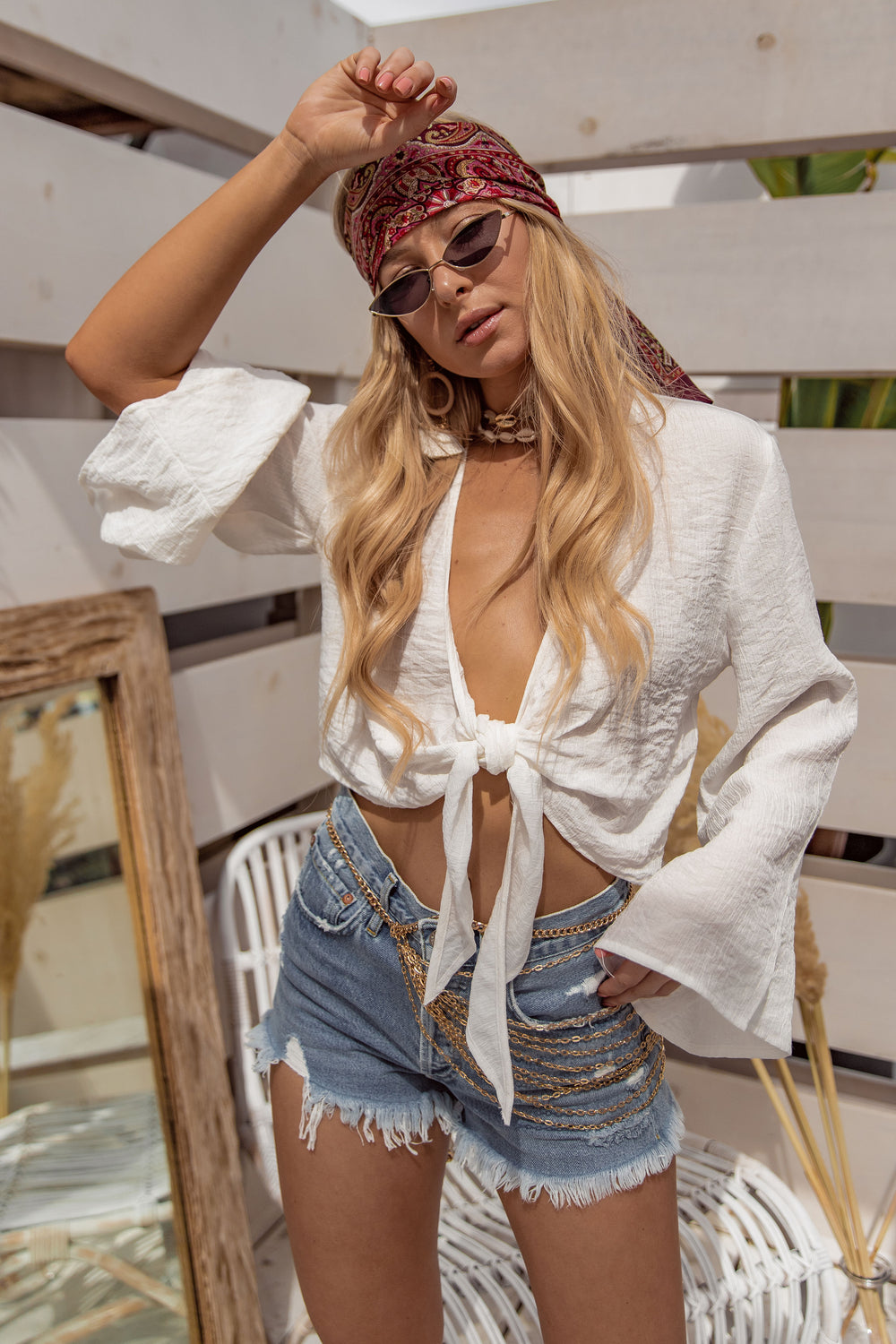 Caught in Capri White Wrap Top