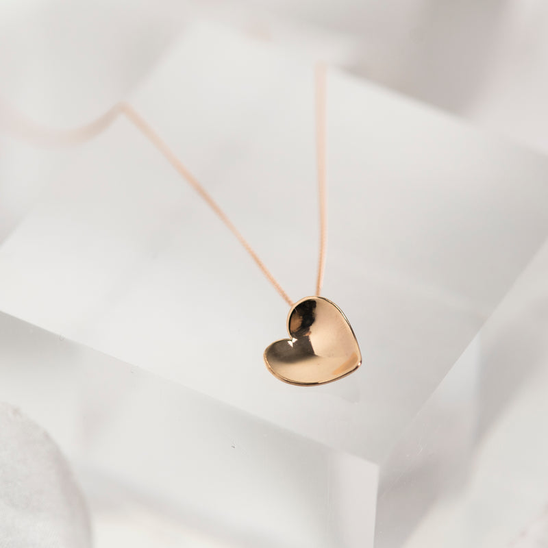 Solid 9 carat rose gold concave heart necklace