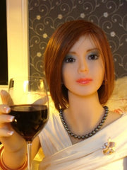 Cindy holding a glass of wine