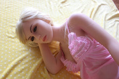Blond Jasmine contemplating in a pink lacy shirt