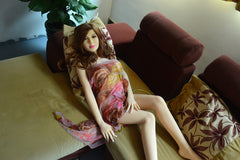 Elizabeth lounging on a plush seat, wearing a sheer cloth