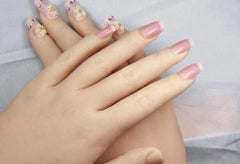 Candy's well-manicured nails
