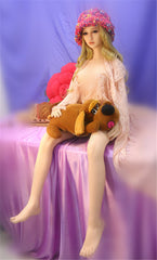 Jennifer sits on purple satin sheets