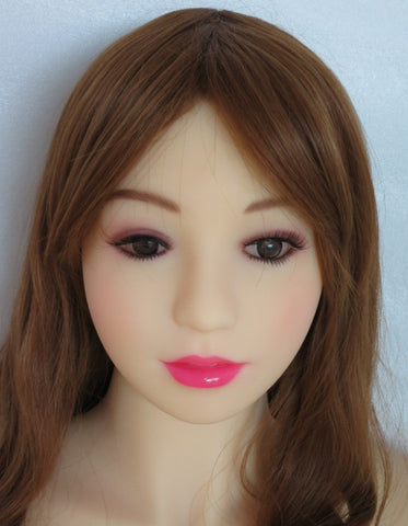 Close-up shot of a doll wearing pink lipstick.