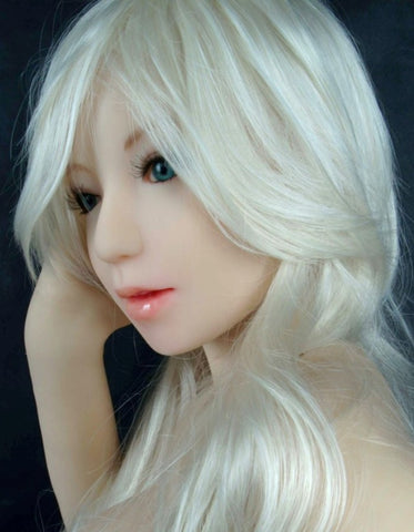 Cherry, a blond sex doll, poses for the camera