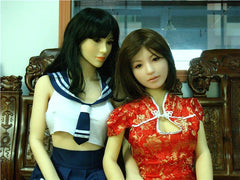 Dolly hanging out with her friend doll while wearing a Chinese dress