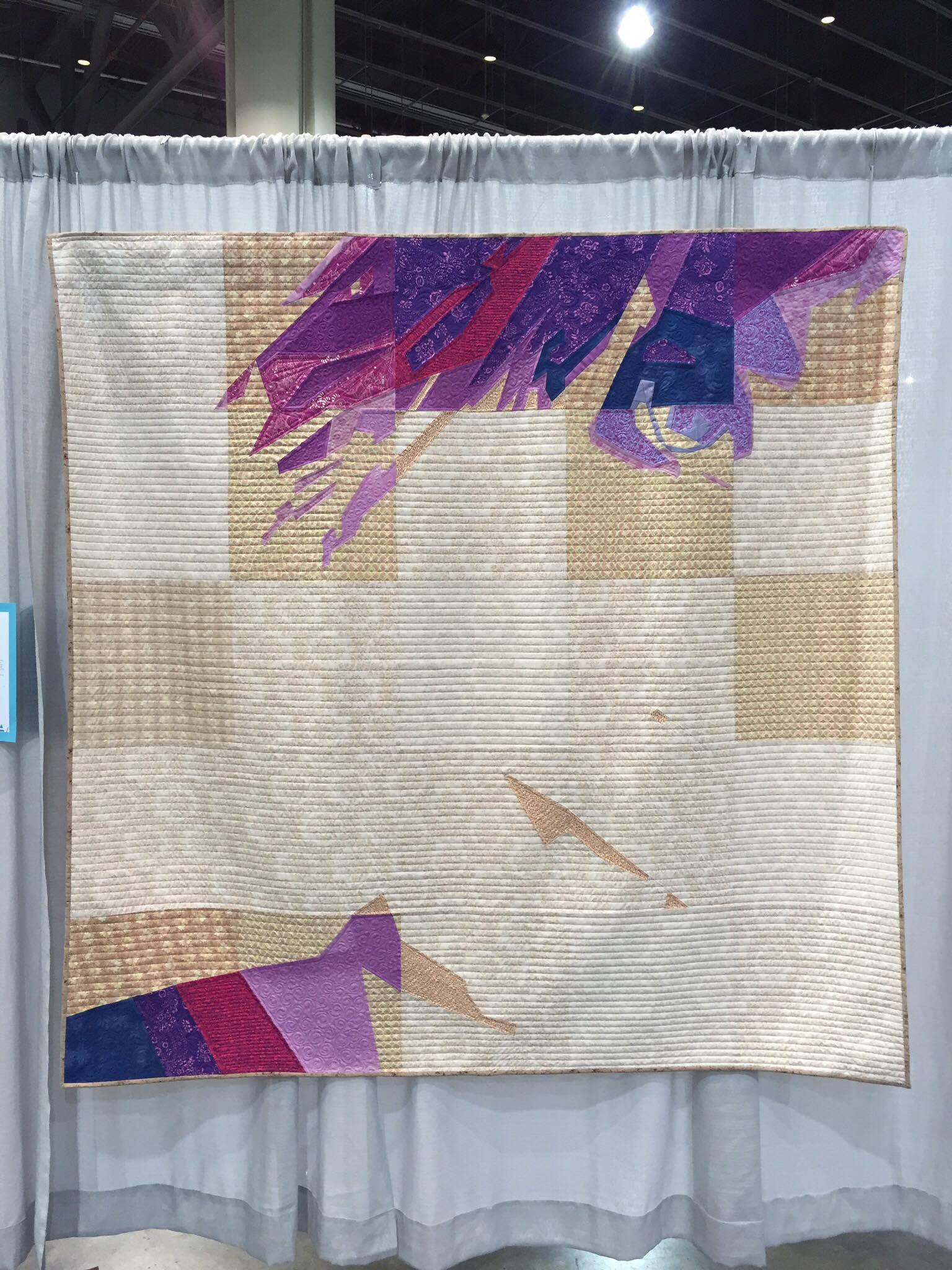 Self Portrait Behind The Pixels quilt at QuiltCon