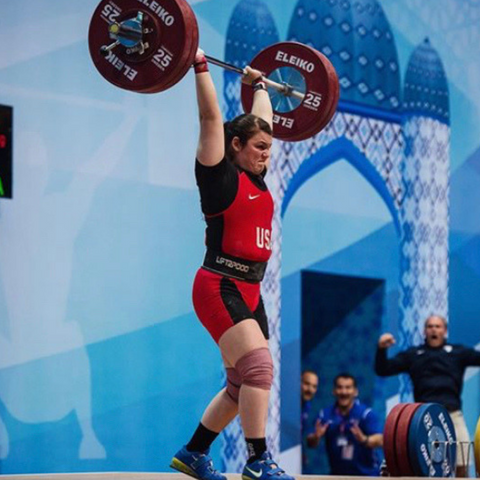 team usa weightlifter on stage