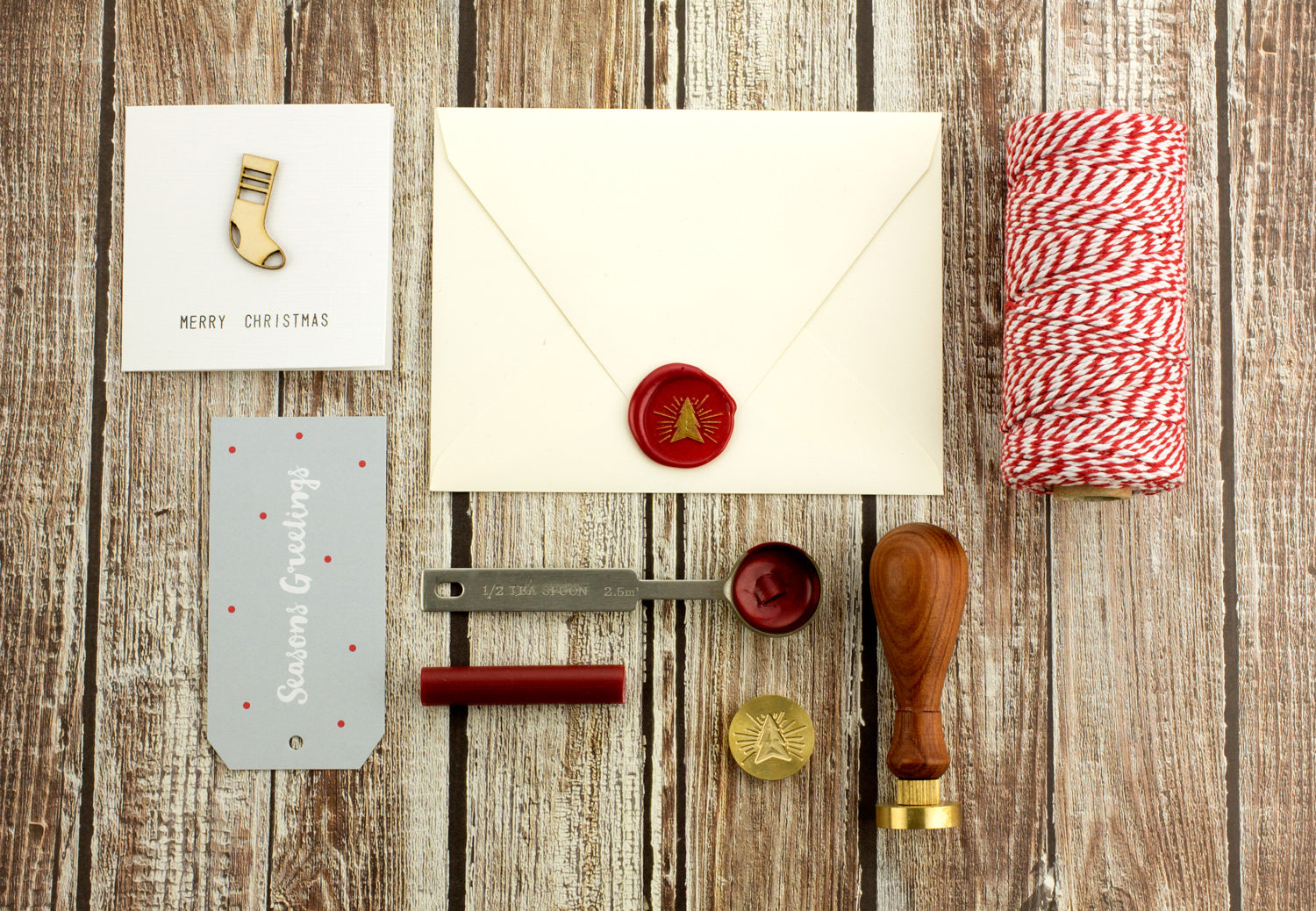 Use a Christmas wax seal stamp from Kustom Haus to decorate your holiday greeting cards and gift wrapping.