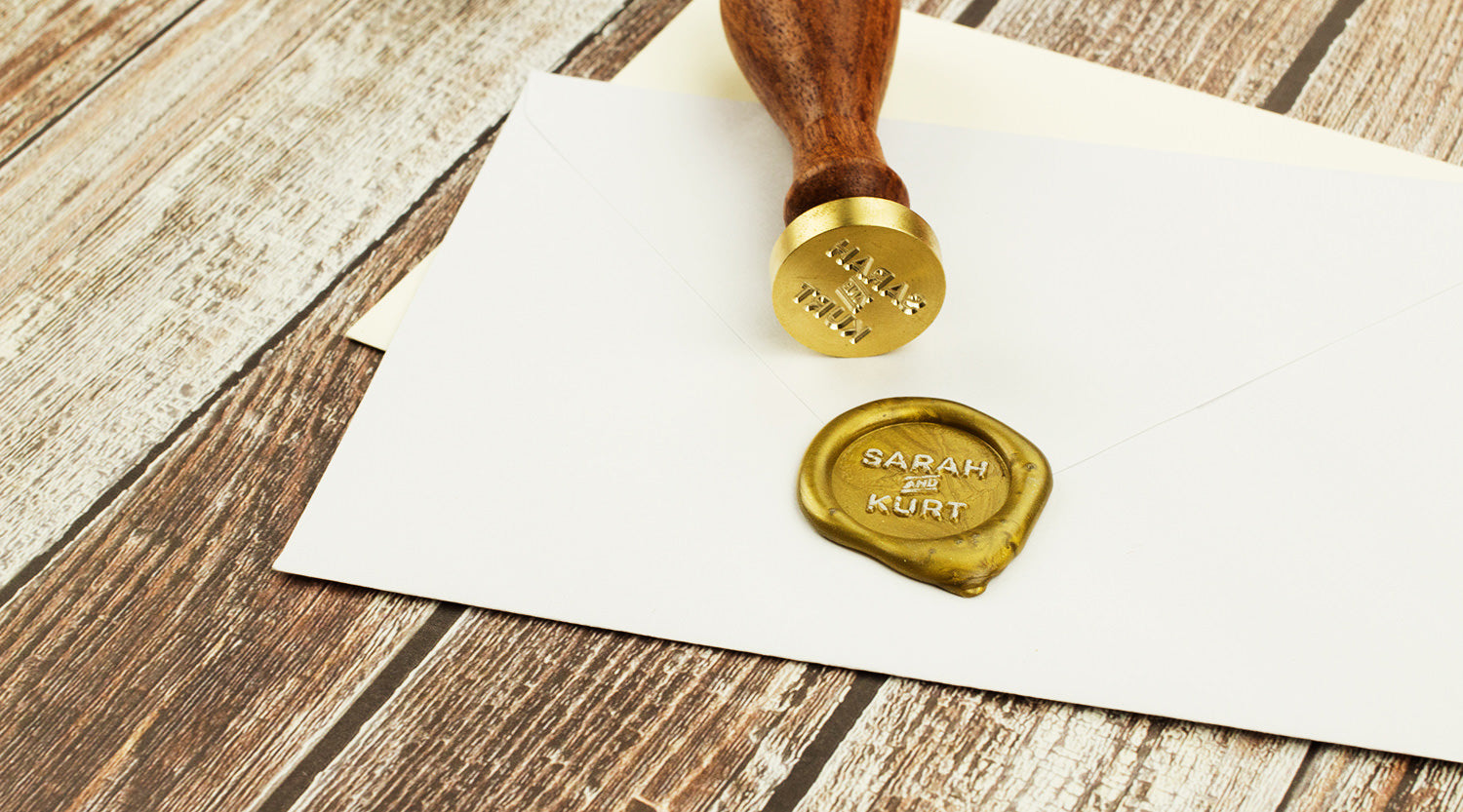 Create a custom wax seal for your wedding invitations.