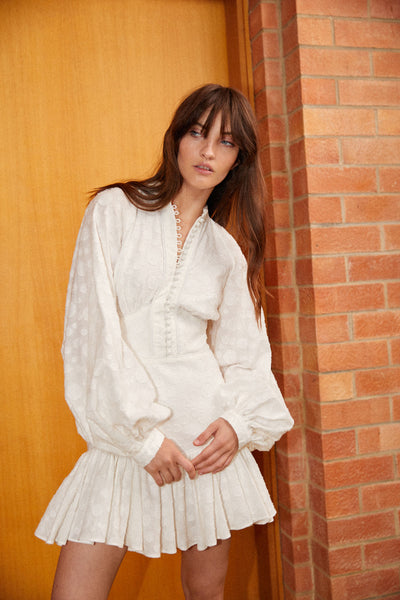 Acler Ivory (white) Bastia mini Dress with exaggerated sleeves.