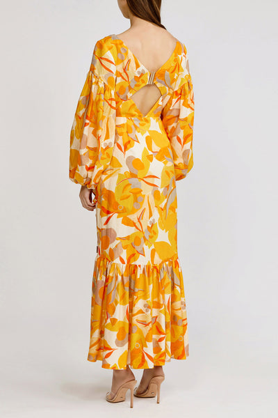 Acler Golden Abstract full length, wrap front Gallion dress with exaggerated sleeves and asymmetrical hemline.