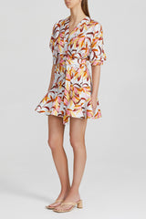 Acler white mini dress with orange floral pattern, fitted waist with twist detail, balloon 3/4 sleeves, peplum frill skirt and v-neckline in exclusive Acler print