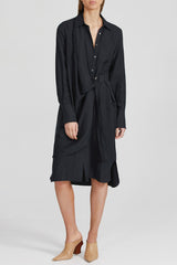 Acler black midi dress with fitted waist, drape v-neckline, collar, wide cuff detail, wrap like detail at waist, relaxed sleeves, curved hemline and side split with inbuilt waist belt in lightweight fabrication