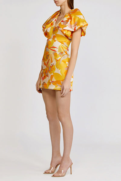 Acler Raven mini dress with low v neckline and exaggerated shoulders in golden abstract.