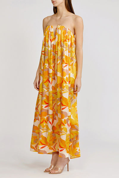 Acler strapless, full length Haslam dress with gathered detail in golden abstract.