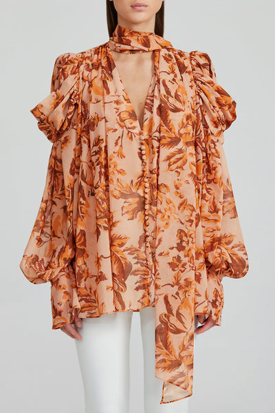 Acler Orange Floral Top with Plunging v-neckline, Exposed Button Fastening, Neck Tie and Exaggerated, Long Sleeves