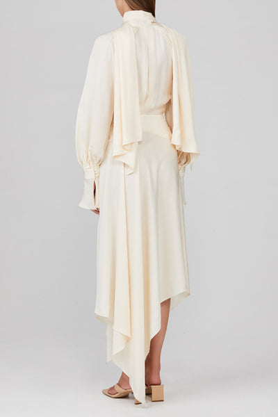 Acler eggshell midi dress with fitted waist, drape v-neckline with tie, wrap and tie detail at waist, open back, long balloon sleeves, asymmetric hem and wide cuff with drape detail in lightweight textured satin fabric