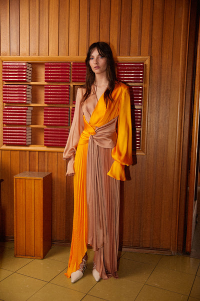 Acler full length, long sleeve Empire dress with v-neckline, pleated asymmetrical skirt and ruched detail at waist in two tone orange and nude (beige/tan)