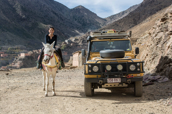 Sophee Smiles - At Home in Morocco - Sophee on Horse With Landrover