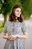 Woman wearing linen floral dress.