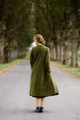 Woman wearing green color long wool coat, image from the back