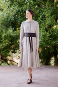Woman in classic linen dress with dark brown linen ribbon belt