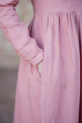 Photo of  a linen smock dress and it's pocket detail