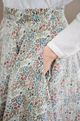 Floral linen Sondeflor skirt with pockets, up close picture of a linen fabric.