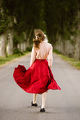 Woman wearing red color linen midi skirt, image from the back