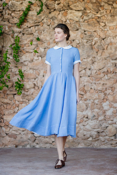 Classic linen dress with short sleeves and flare skirt in light blue color