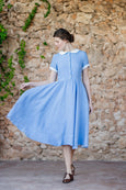 Light blue linen dress with white collar and white rolled up sleeves