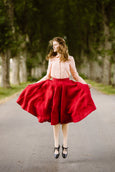 Model wearing red color linen midi skirt, image from the front