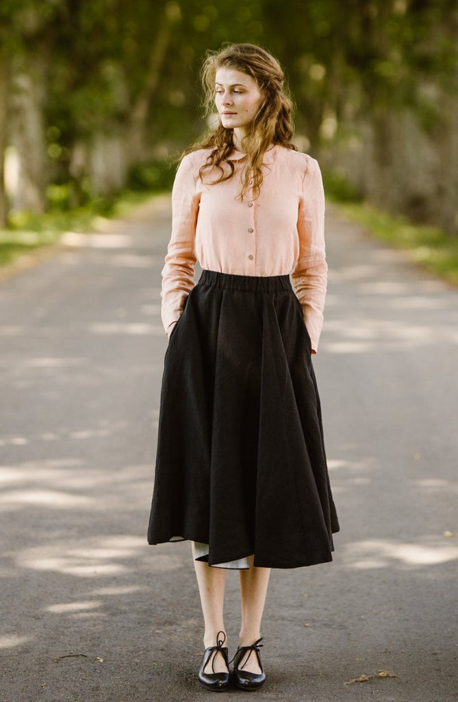 Woman wearing black linen midi skirt, image from the front