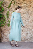 Woman walking in long green linen dress