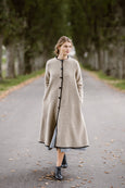 Woman wearing beige color long wool coat, picture from the front