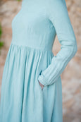 Up close detail of linen smock dress in mint green color