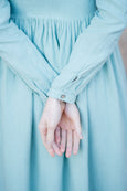 Up close picture of light green linen dress in mint green