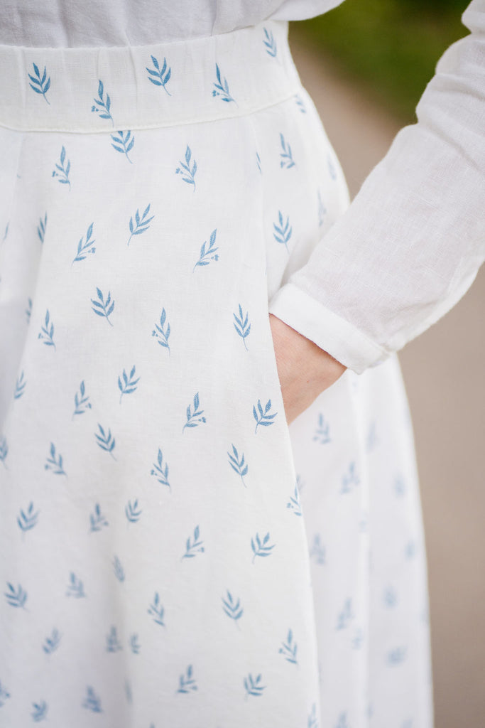Softened linen white skirt with floral details, up close image of a pattern