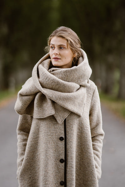 Woman wearing beige color wool shawl, image from the front