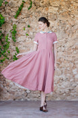 Classic style linen dress with short sleeves and flare skirt in light pink color