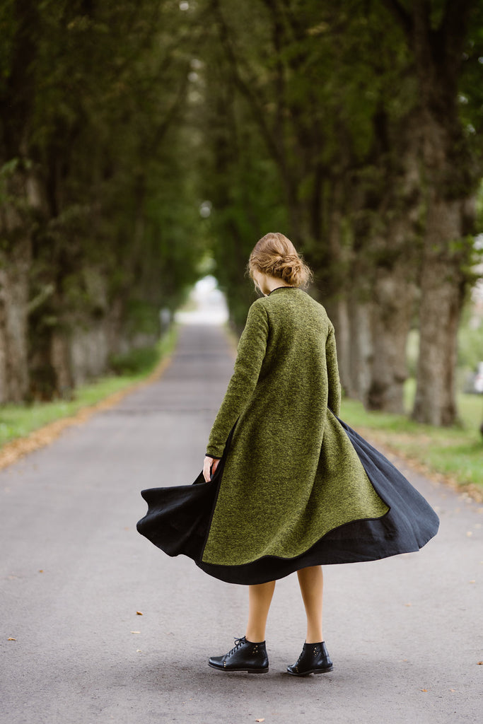Woman wearing green color long wool sweater, picture from the back